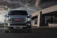 http---image.motortrend.com-f-roadtests-trucks-1401_2015_gmc_canyon_first_look-60391778-2015-GMC-Canyon-front-profile