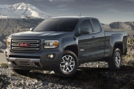 http---image.motortrend.com-f-roadtests-trucks-1401_2015_gmc_canyon_first_look-64739389-2015-GMC-Canyon-front-three-quarters-view-01
