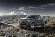 http---image.motortrend.com-f-roadtests-trucks-1401_2015_gmc_canyon_first_look-66866106-2015-GMC-Canyon-front-three-quarters
