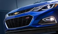 The Cruze headlamps sweep back into the front fenders and an expressive, stacked dual-port grille design offers upscale attention to detail. LT and Premier models feature premium forward lighting systems, including projector-beam headlamps and LED signature daytime running lamps.